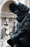 Street Performer in Rome Italy. Man performing on the street by Trevi Fountain as a frozen statue in Rome Italy Royalty Free Stock Images