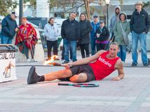 Street performer shows stunts on Mallory Square of Key West. Florida. January 18, 2018 Royalty Free Stock Photo