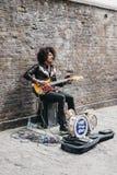 Street performer singing on Brick Lane, London, UK. stock images