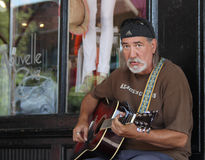 Street performer singing in historic downtown district Royalty Free Stock Image