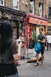 Street performer singing and playing guitar at Columbia Road Flower Market, London, UK. royalty free stock images