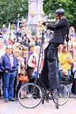 Street performer with special bike. Doing his act during the event called deventer op stelten in the dutch city deventer, the netherlands. This year 130.000 Stock Images