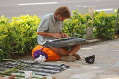 Street Performer. Young man playing keyboard on street in Honolulu, Hawaii for donations Stock Images