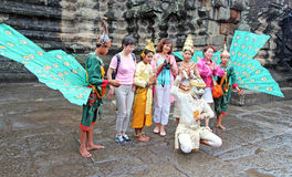 Street Performers. Cambodian Street performers posing with tourists next  to Angkor Wat in Siem Reap,Cambodia Royalty Free Stock Photo
