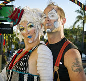 Street Performers, California. Street performers in make-up and costume entertain at the Holiday Carnivale celebrating the Christmas and Chanukah (Hanukkah) royalty free stock image