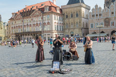 Street performers in costume play Celtic in  Old Town Square in Royalty Free Stock Images