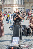 Street performers in costume play Celtic in  Old Town Square in Royalty Free Stock Photo