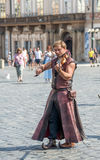 Street performers in costume play Celtic in  Old Town Square in Stock Image