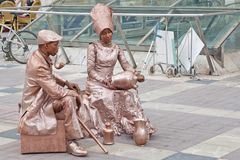 Free Street Performers Couple Entertainers Royalty Free Stock Photos - 108616898