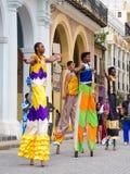 Street performers dancing on stilts in Old Havana Stock Image