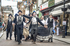 Street performers at Dickens Festival. Rochester, United Kingdom - June 11, 2017: Twice a year Dickens enthusiasts, strolling players, re-enactors, Dickensian ` Royalty Free Stock Photo