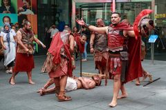Street performers reenacting the crucifixion royalty free stock images