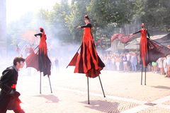 Street performers on stilts. Street performers walking on stilts of the group close act, doing their act during the event called deventer op stelten in the dutch Stock Images