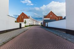 View town Oosterhout Netherlands, Europe, new small houses, resi. Street perspective with facades of new small houses, residential area town Oosterhout Stock Photography