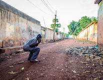 Street photo. Jinja, Uganda -September 2015 - A drunkard man posses for a photo. Uganda was ranked number 1 in Africa and 9th in the world by a recent survey on Royalty Free Stock Image