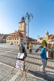 Street photographer on the central square of the old Brasov in Romania stock image