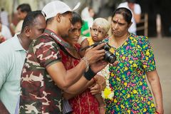 Street photographer demonstrates shots to his clients at Batu caves in Kuala Lumpur, Malaysia. Royalty Free Stock Photography