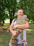 A street photographer with his pets - a crocodile and snakes. Royalty Free Stock Photography