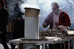 Street Photography 66: The bake nut seller Stock Image