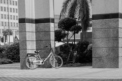 Street Photography Bicyce Parking Alone. Street photography image of bicycle parking o its own against the wall Stock Photo