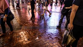 Street photography of Hong Kong life at night. Colorful neon lig. Ht reflect on street Stock Photos