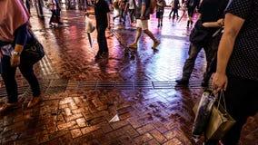 Street photography of Hong Kong life at night. Colorful neon lig Stock Photos