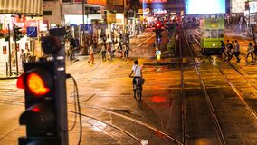 Street photography of Hong Kong life at night. Colorful neon lig. Ht reflect on street Royalty Free Stock Photography