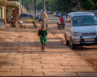 Street photography. Jinja, Uganda -September 2015 - A young boy heads back home, from school. The so many private schools in the town make the streets flooded Stock Images
