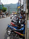 Street on Phuket, Thailand. Scooters on street in Phuket, Thailand. Region near Kata beach Royalty Free Stock Photo