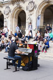 Street pianist entertains the audience Stock Photos