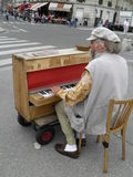 Street piano player in Paris Stock Photos