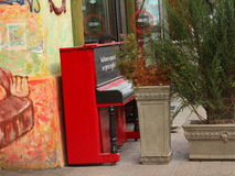 Street pianos in the center of Kyiv. Piano standing alone at cafe Royalty Free Stock Image