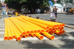 Street a pile of plastic pipe Stock Image