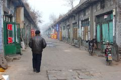 Man in misty street in rustic Pingyao Ancient walled City (Unesco), China Stock Image