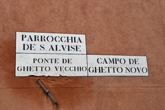 Street plate on the wall in jewish quarter of Venice. Italy stock photo