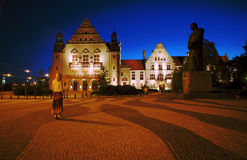 Street and plaza in Poznan by night Stock Photos