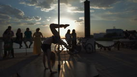 Street Pole dance on sunset out of focus stock footage video stock video