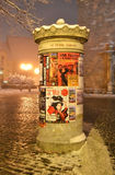 Street poles covered with posters at night Stock Photography