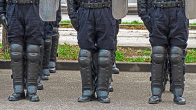 Street police forces in alignment Stock Image