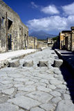 Street of Pompeii. Ancient street leading up to Mt Vesuvius with stepping stones to help get you across the street when it rains and chariots horses would not Stock Images