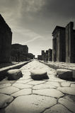 Street in Pompeii, Italy. Paved street in the antique site of Pompeii, Italy Royalty Free Stock Image