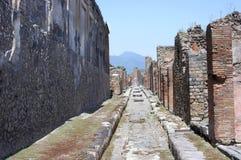 Street in Pompeii ruins near volcano Vesuvius Stock Photos