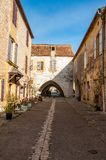 Street and porch the village of Monpazier, Perigord, France stock images