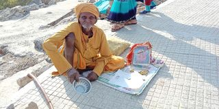 Old man beggar on street india