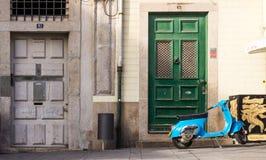 View of street in Porto, Portugal. Street of Porto and vintage vespa, Porto, Portugal Royalty Free Stock Photo