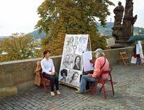 Street portrait artist painting Asian girl Stock Images