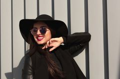 Street portrait of happy woman in trendy wide brimmed hat and st Royalty Free Stock Photo