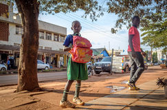 Street portrait. Jinja, Uganda -September 2015 - A young boy on his way home, from school, posses for a photo Royalty Free Stock Photography