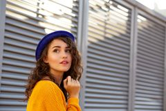 Street Portrait Of Awesome Model Wearing Blue Hat Posing With Su Royalty Free Stock Images