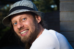 Street portrait of a smiling man in a stylish hat stock images